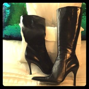 Up to the knee black leather boots